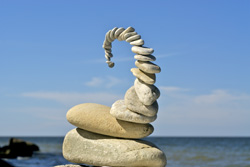 A balanced stack of stones on a beach