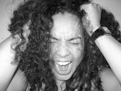 Woman screaming and pulling her hair