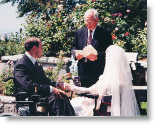 Darrell and Glenda, both in wheelchairs, exchanging their wedding vows