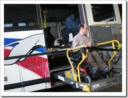 Darrell using the wheelchair lift to board the Greyhoound bus