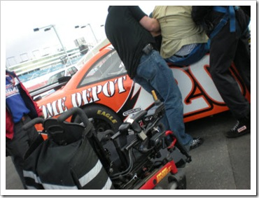 Darrell being lifted into a NASCAR