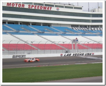 Darrell in a NASCAR racing around the track