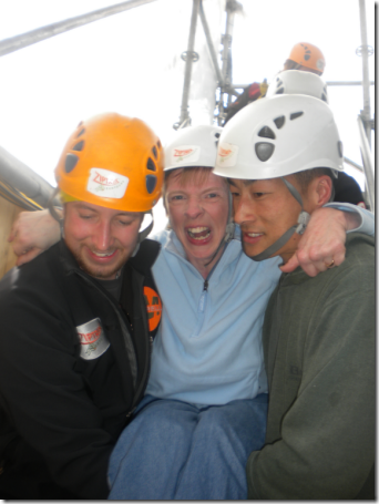 Glenda being carried by two guys doing the firemen's chair