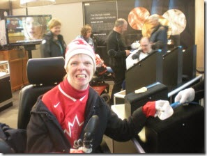 Glenda touching a 2010 Paralympic silver medal