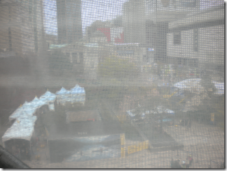 A view of Robson Square through the meshed fabric