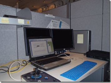 My work space in a partial cubicle