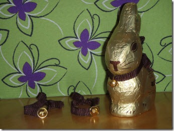 Lindt Easter bunny beside two empty collars