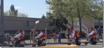 Shriners on small motorbikes