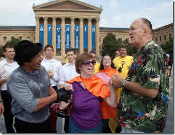 Mike Kunda, Glenda Watson Hyatt and Chuck Wepner standing at the top of the Rocky steps