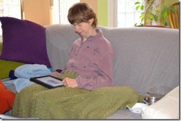 Glenda sitting beside Faith under the blanket