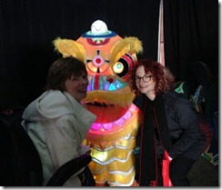 Glenda and Avril next to a colourful dragon lantern
