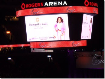 Promo shot of Oprah on the jumbo screen above