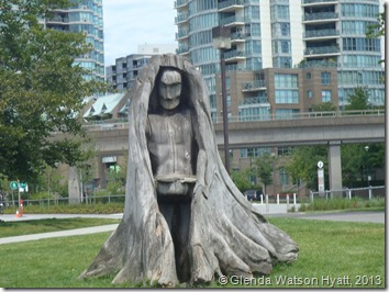 A person carved into a tree stump, silvered with age