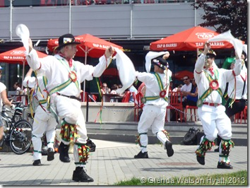Men in ethnic costume dancing