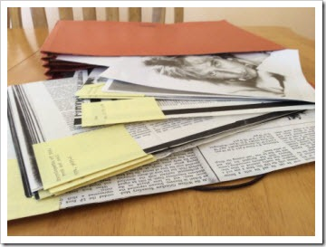 Print outs of magazine articles with post-it notes neatly attached