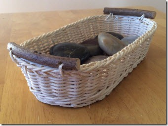 Small wicker basket filled with rocks