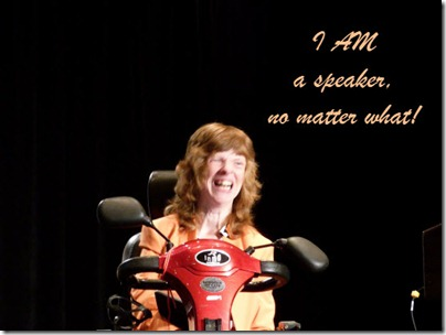 "Glenda speaking on stage, with the text ""I AM a speaker, no matter what!"" superimposed on photo"